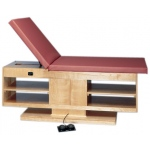 "wooden treatment table - electric hi-low, shelves, upholstered, 78"" L x 30"" W x 27"" - 39"" H, 2-section"